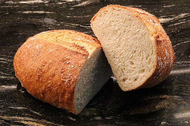 A freshly cut home-baked bloomer loaf, ready to eat