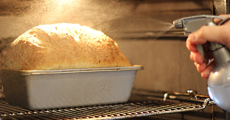 Spraying the loaf in the oven