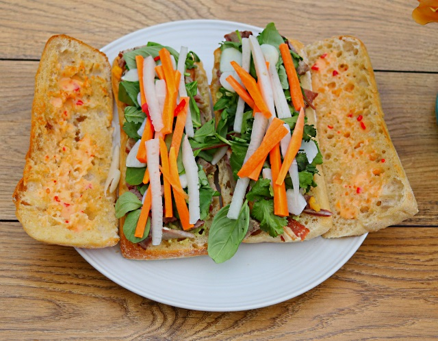 Banh mi ingredients layered onto the two paninis