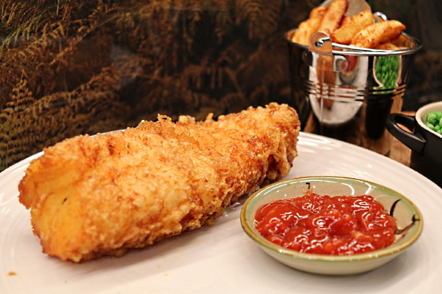 Beer battered fish with tomato sauce, peas and chips