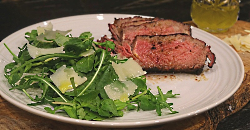 Beef tagliata using reverse seared rib-eye steak