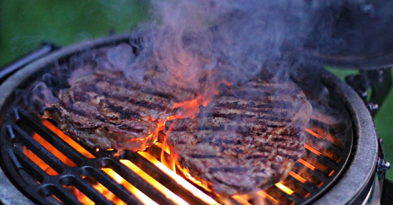 Searing rib-eye steaks ... spattering fat and blowing smoke onto the Egg