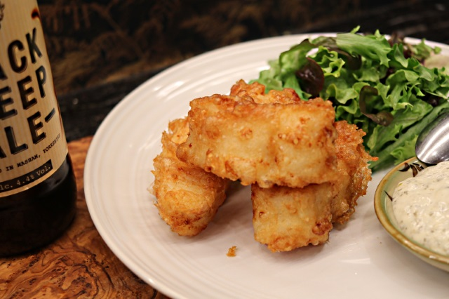 Battered goujon served with tartar sauce and salad