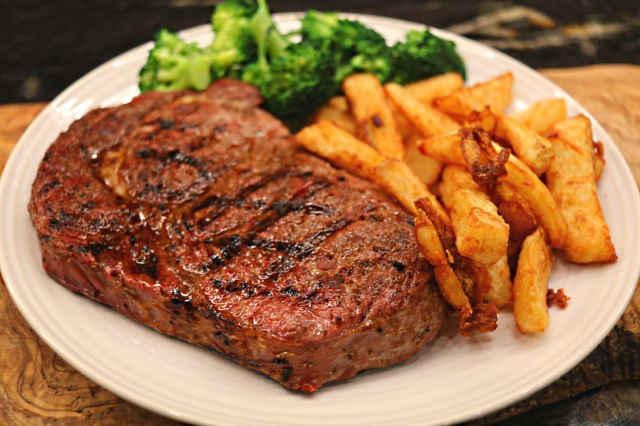 Sous vide rib-eye steak with triple cooked chips and broccoli