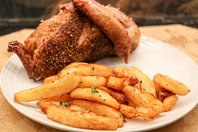 Truffle and parsley chips served with roast duck rubbed with Dizzy Pig Game On