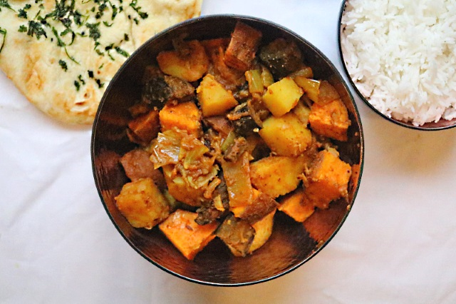 Sweet potato and aubergine curry with rice and naan bread