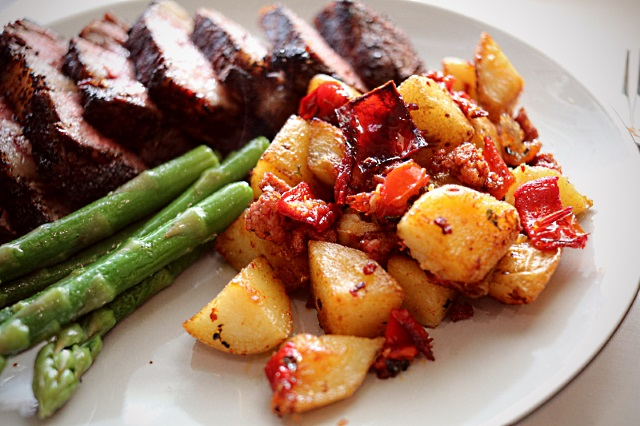 Sautéed potatoes with red pepper and chorizo, asparagus and steak