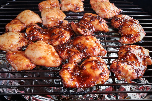 Chicken thighs cooking in a Big Green Egg