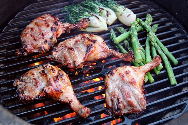 Searing duck legs and vegetables in a Big Green Egg