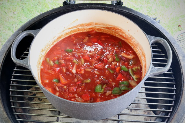Chili ready to have ball of meat placed on top and cooked