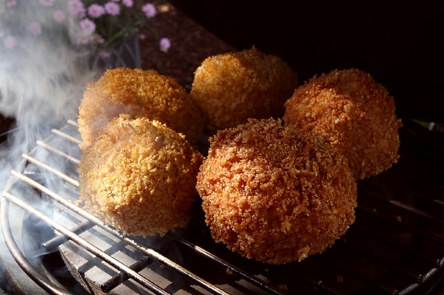 Scotch eggs smoking in a Big Green Egg