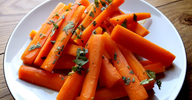 Honey glazed carrots with cumin served as a shared side dish