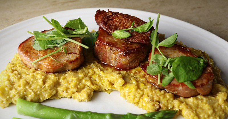 Pork fillet with sweetcorn puree and pea shoots