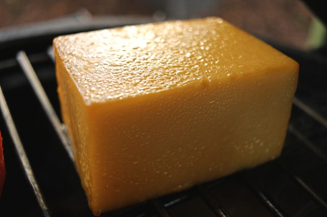 Cheddar at the end of smoking with oil on the surface