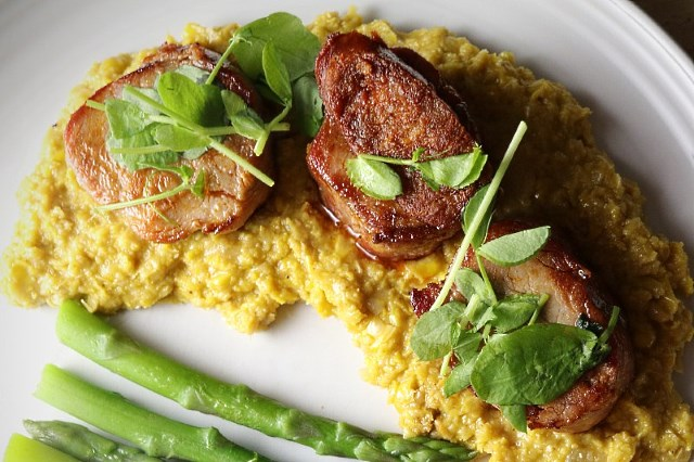 Pork fillet with sweetcorn puree served with asparagus tips