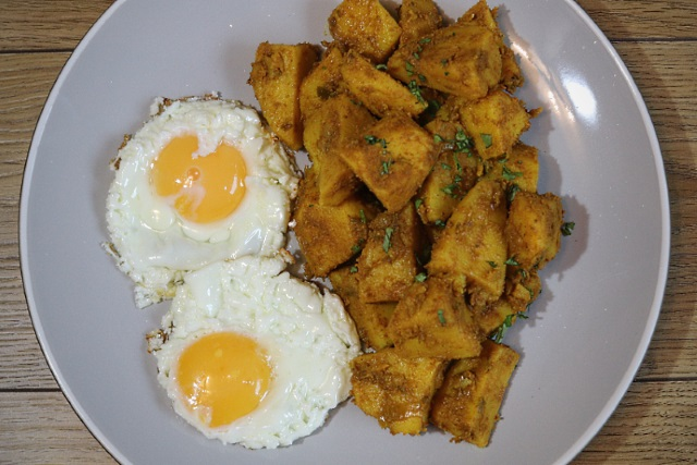 Leftover aloo jeera with fried eggs