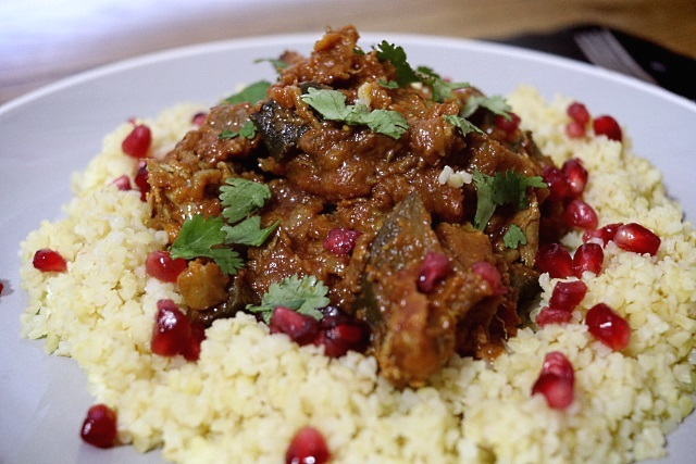 Lamb tagine with vegetables served with bulgar wheat and pomegranate seeds