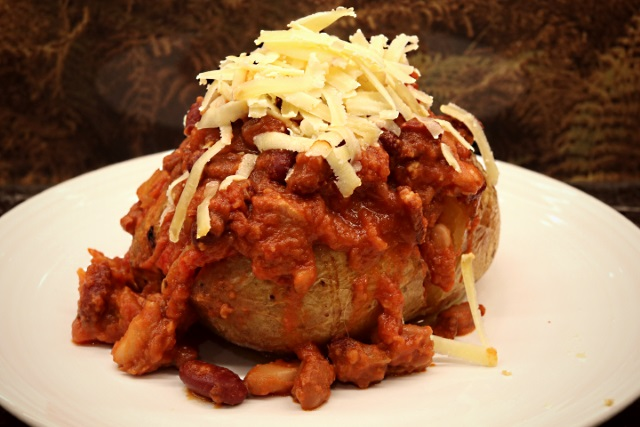 Smokey chipotle beans with a baked potato and grated cheese
