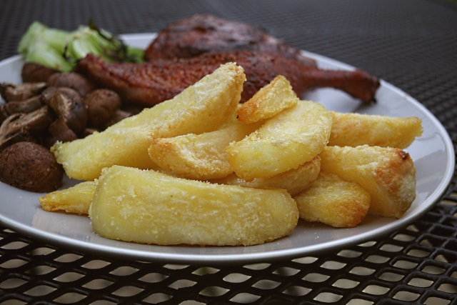 Ramos potato wedges served with roast duck and pak choi