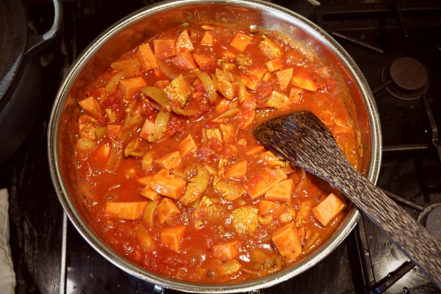 Simmering after adding tomatoes and coconut ingredients