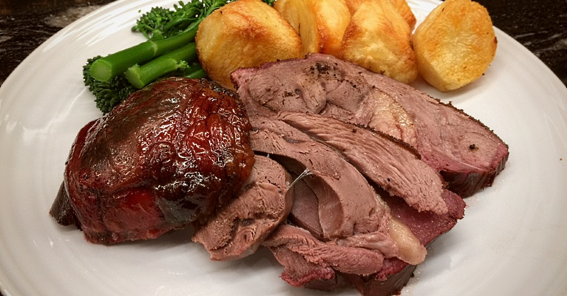 Roast leg of mutton with roast potatoes and broccoli