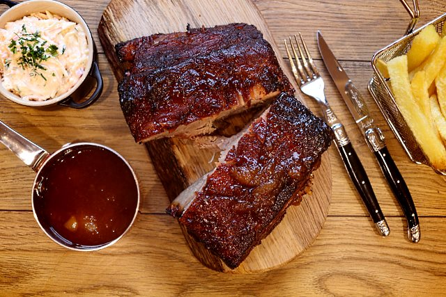 Apricot preserve glazed pork served with sauce and sides