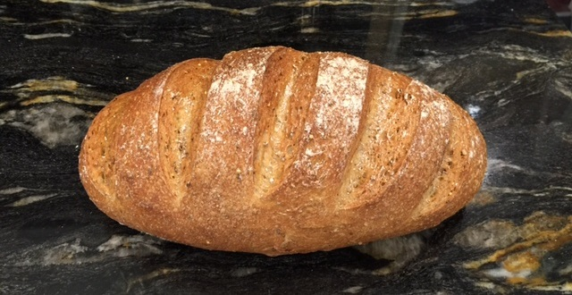 Bloomer loaf with grooves from scoring the dough