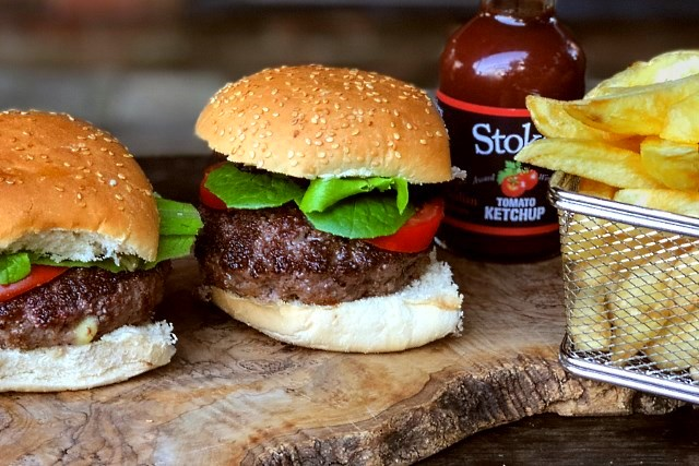 Jucy Lucy burgers served with chips and Stoke's ketchup