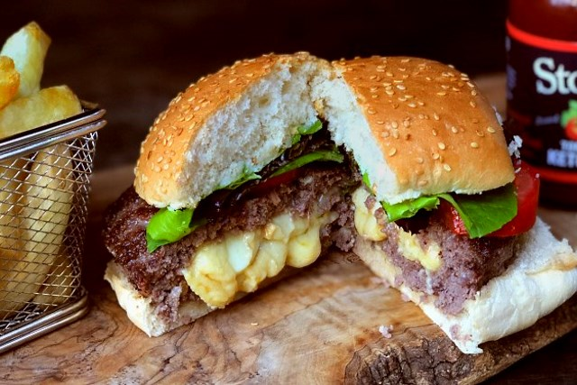 Jucy Lucy burger cut open revealling the cheese centre