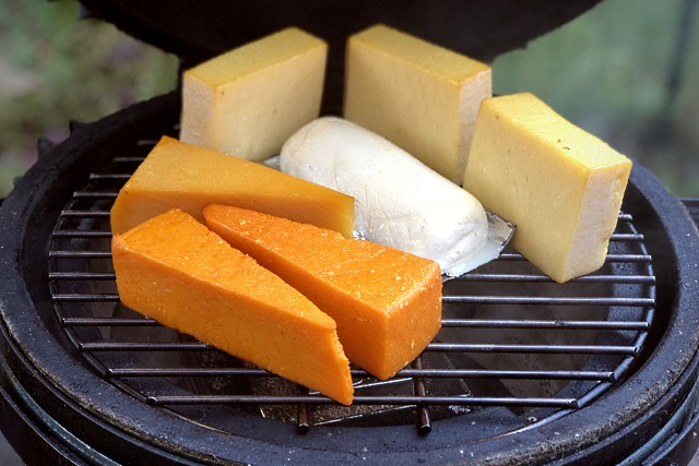 Smoking the Red Leicester, cheddar and mozzarella over apple