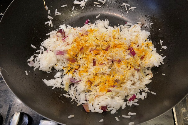 Turmeric added to the rice for colour