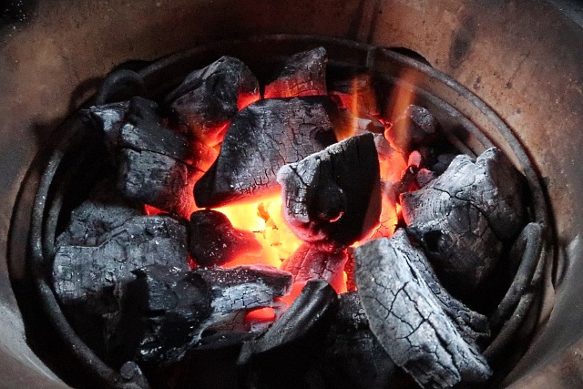 Charcoal hot and ready to cook the pork