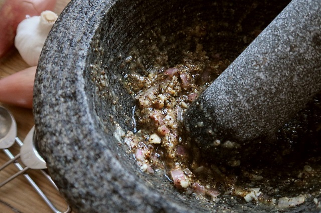 Paste ingredients combined with a pestle and mortar