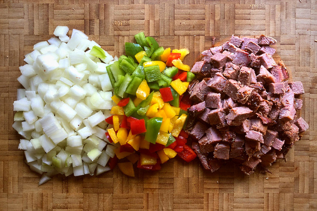 Onion, peppers and brisket cut up and ready to cook